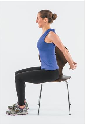 کشش عضلات پشت در حالت نشسته برای درمان اسپاسم کمر